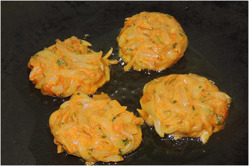 Onion pakoda in malvani gravy in pan